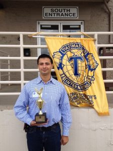 Picture showing Shankar Poncelet after winning a Toastmasters International public speaking contest.